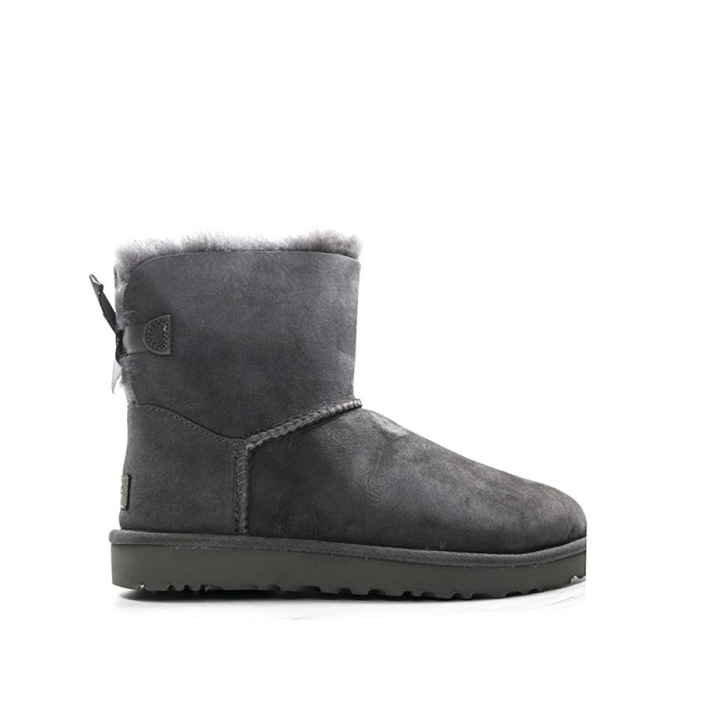 Picture Of white ugg boots with faux fur and bows are chic